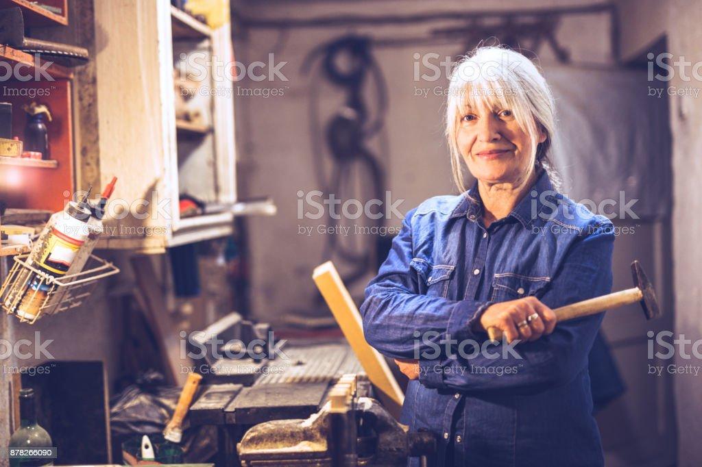 Female carpenter in a workshop stock photo