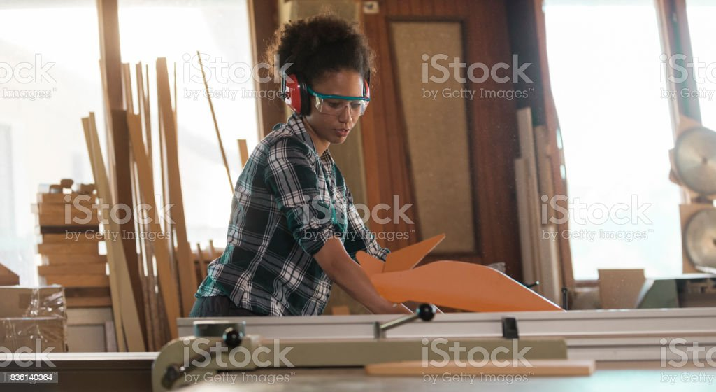 Female Carpenter In Her Workshop stock photo
