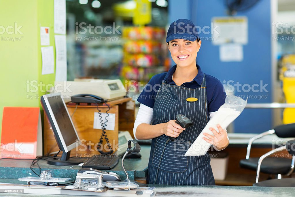 female cashier at hardware store stock photo
