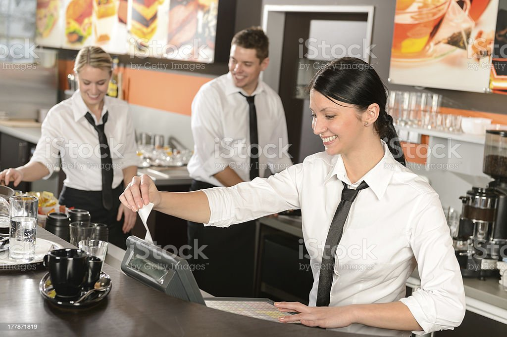Female cashier giving receipt working in cafe stock photo