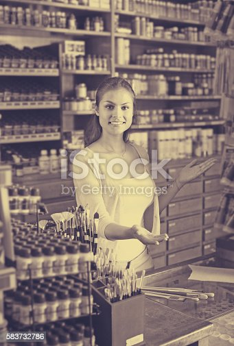 594918592 istock photo female cashier standing in art shop 583732786
