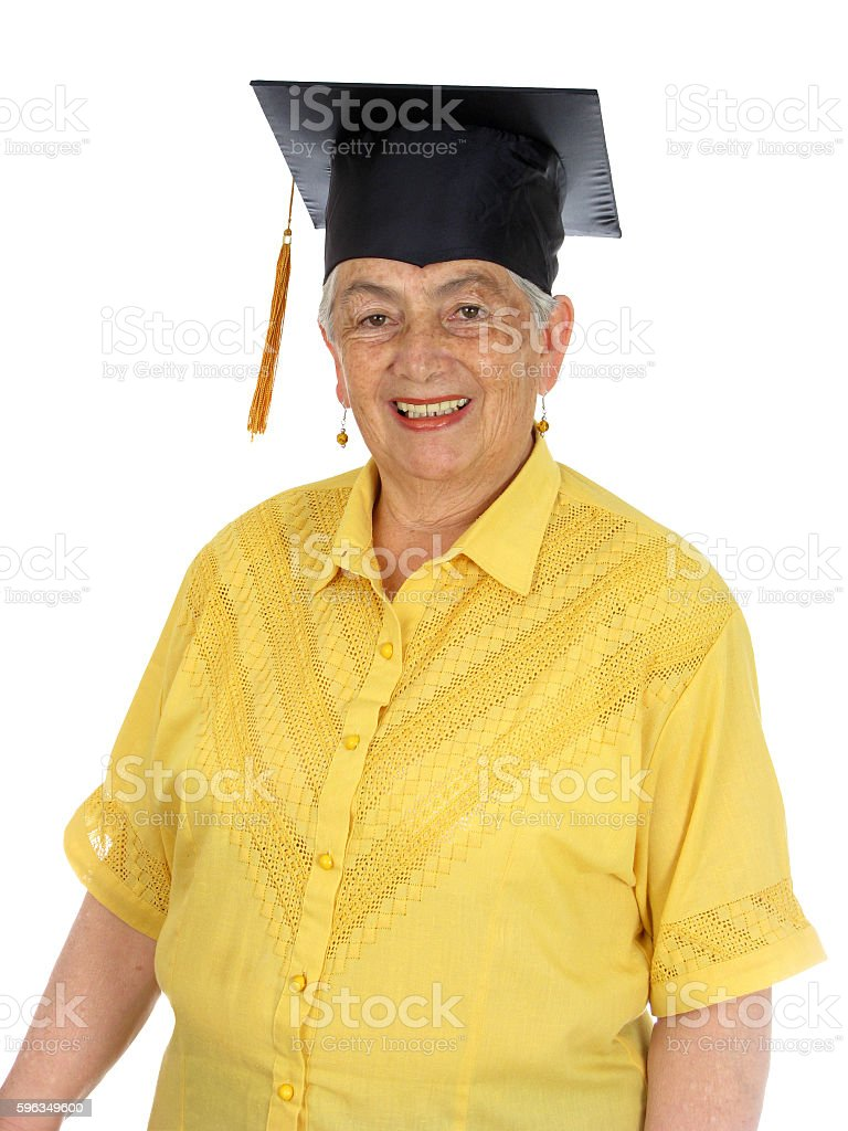 Female caucasian in yellow graduation gown and very excited. royalty-free stock photo