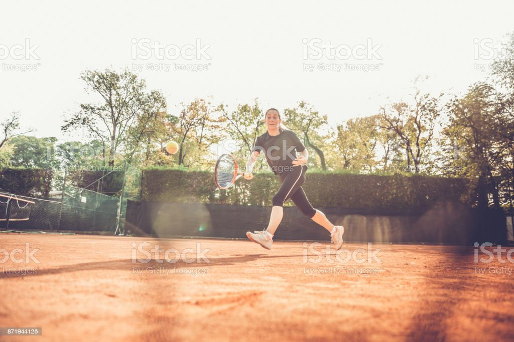 Female Chasing the Ball stock photo