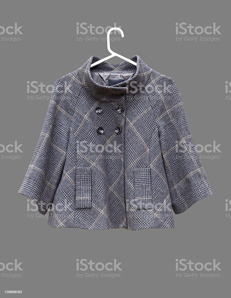Female checked grey jacket hanging on white coat hanger royalty-free stock photo