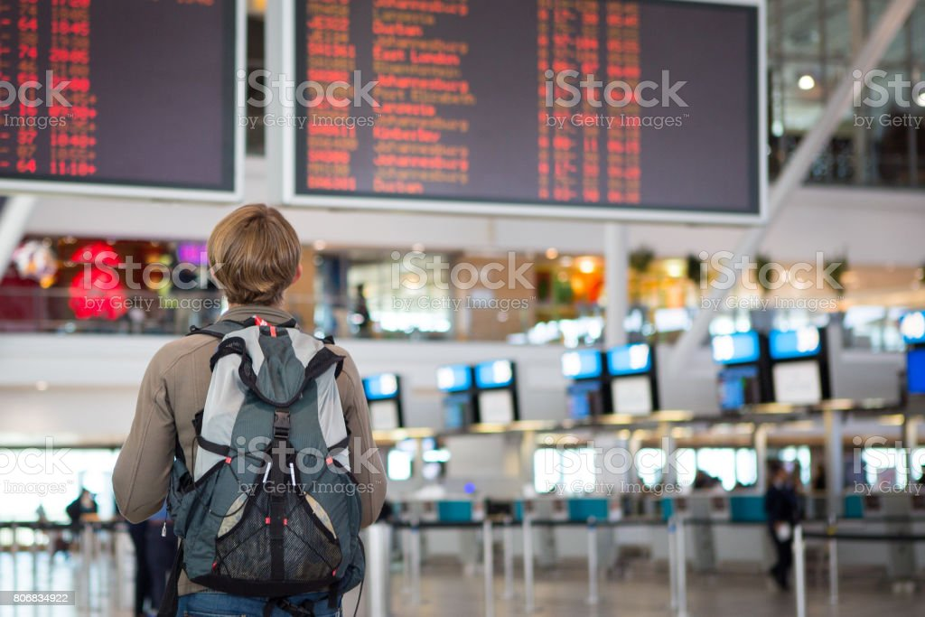 Female checking airline schedule stock photo
