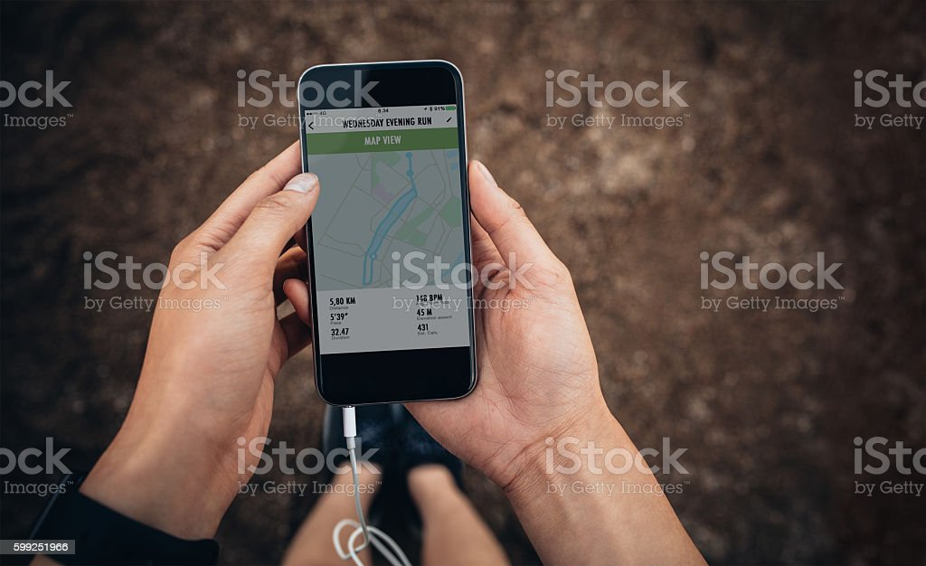 Female checking the summary of her run on mobile phone stock photo