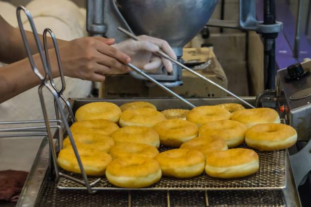 Female Chef Fried doughnut in Berkeley shop Food Dessert Concept stock photo