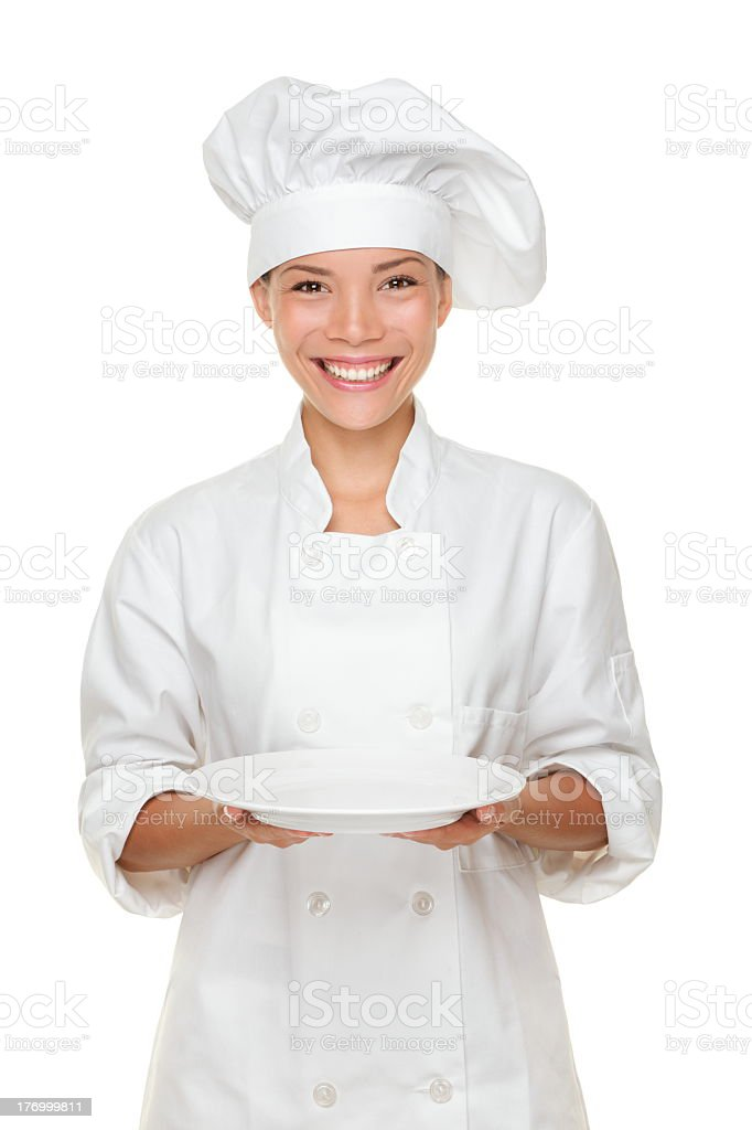 A female chef holding an empty plate stock photo
