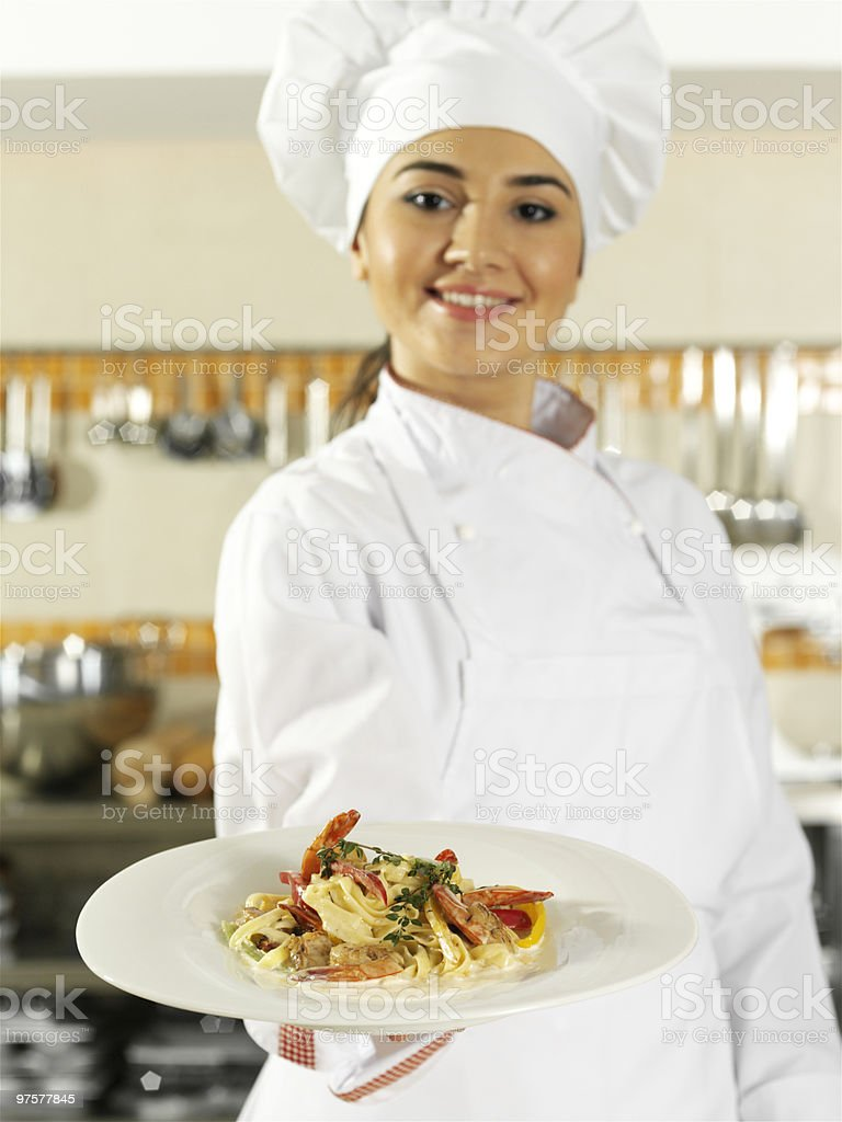 Female chef holding food plate royalty-free stock photo