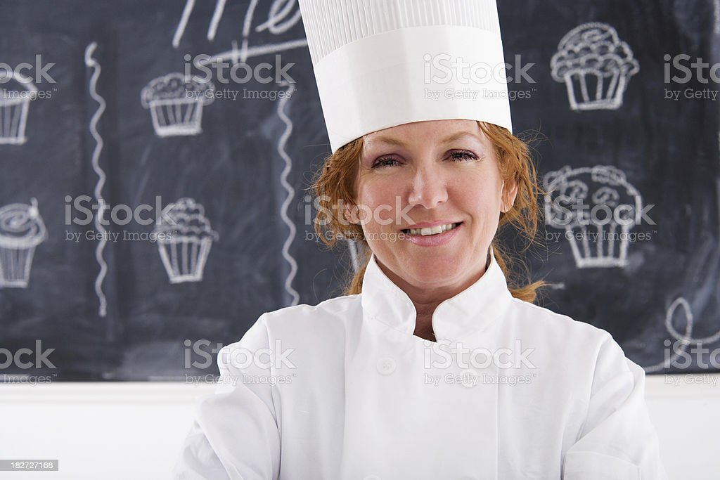 Female Chef  in Front of Menu Board royalty-free stock photo