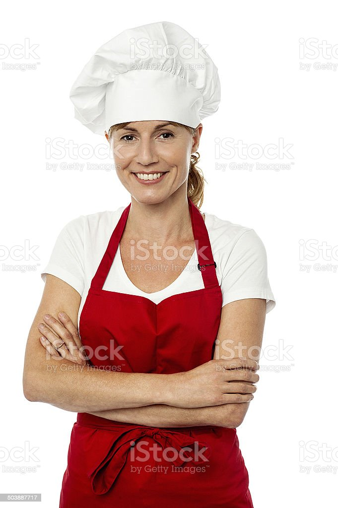 Female chef posing with folded arms stock photo