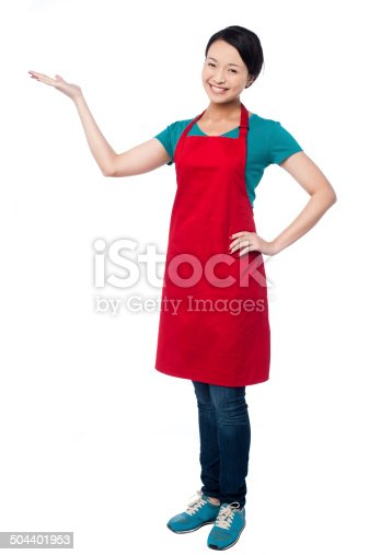 istock Female chef promoting bakery product 504401953