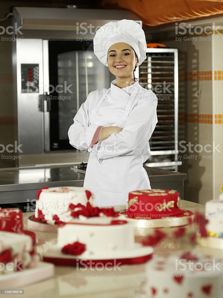 Female chef showing cakes stock photo