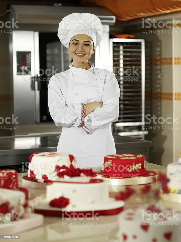 Female chef showing cakes royalty-free stock photo
