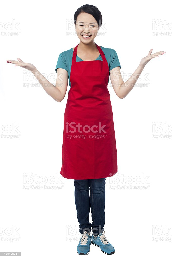 Female chef welcoming you with a smile stock photo