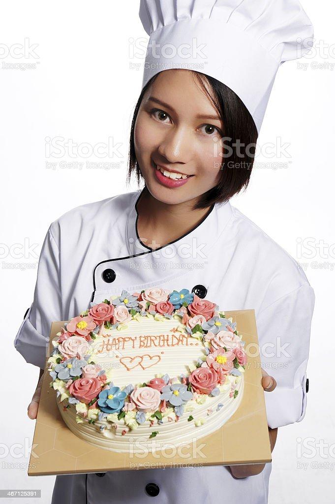 Female chef with appitizing cake royalty-free stock photo