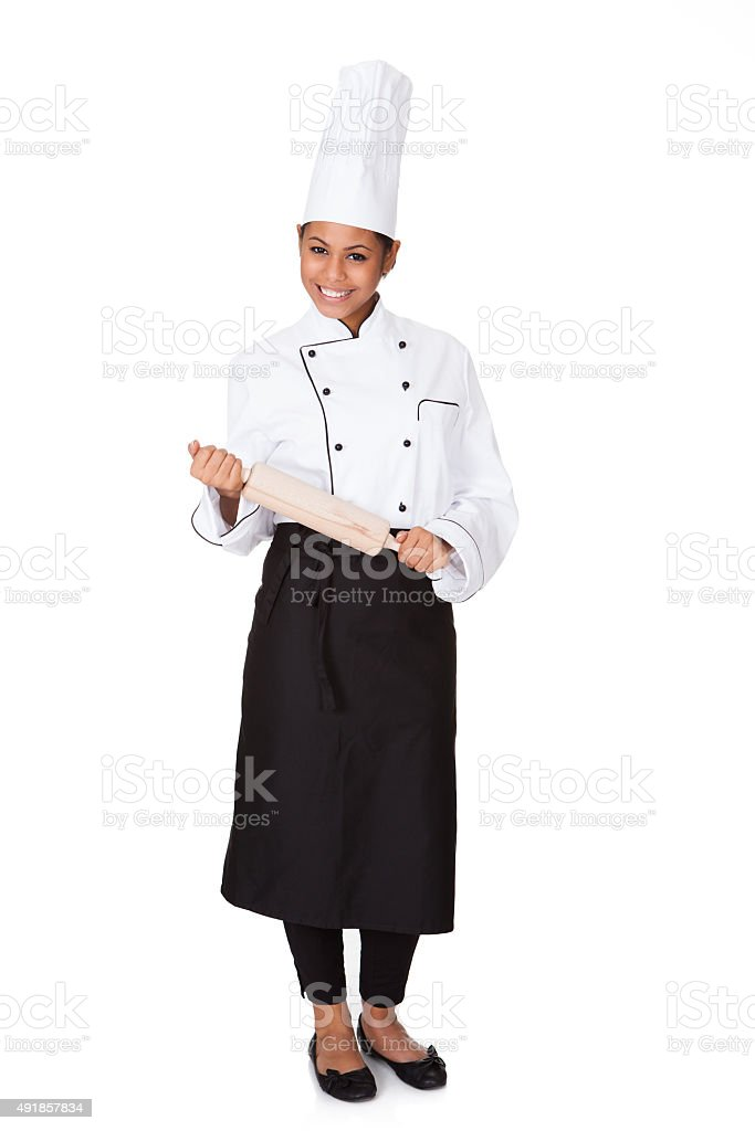 Female Chef With Battledore In Hand stock photo