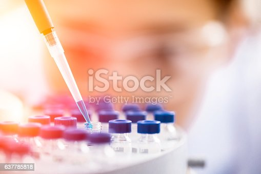 istock Female chemist at work in laboratory. 637785818