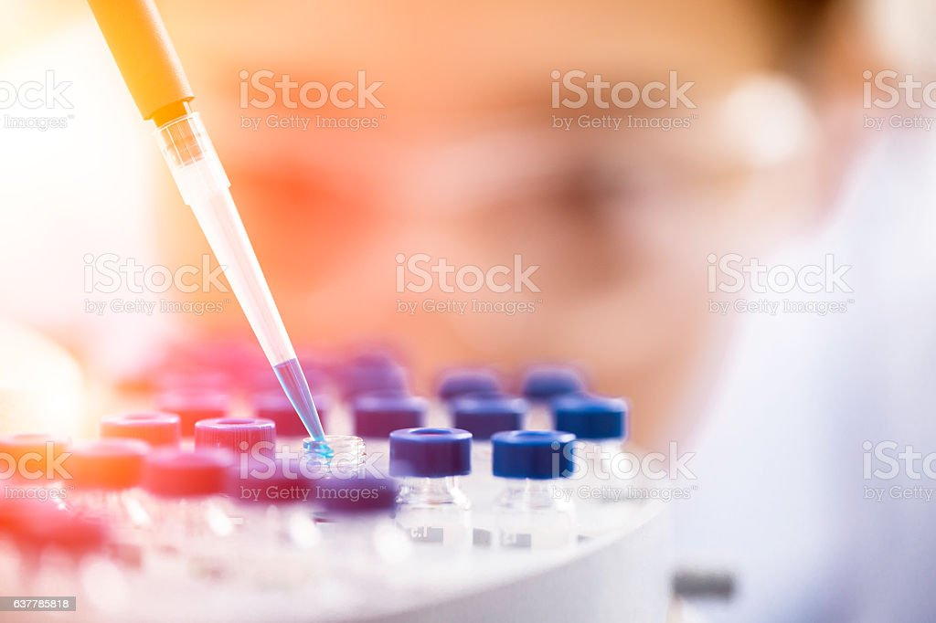 Female chemist at work in laboratory. stock photo