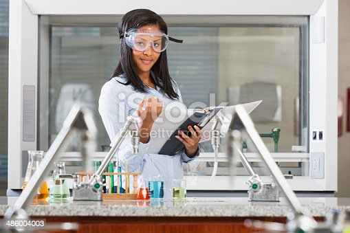 istock Female chemistry student doing a science experiment 486004003