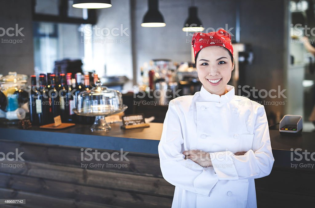 Female Chief Chef in a Restaurant stock photo