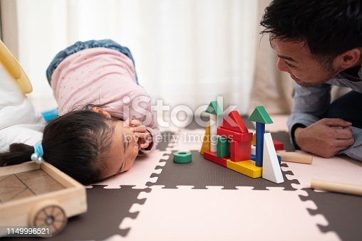 istock Female child and father playing with building blocks 1149996521