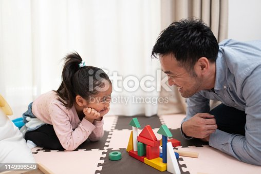 istock Female child and father playing with building blocks 1149996549