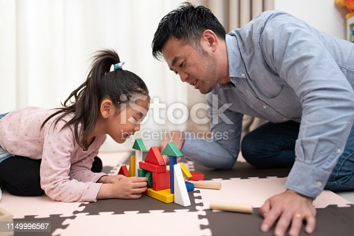 Togetherness of father and his daughter in house. Father taking care of daughter.