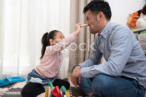 istock Female child and father playing with building blocks 1149996659