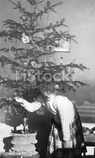 1955 female child playing with christmas tree