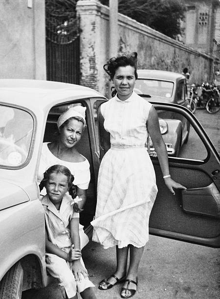female child with family inside car,1951. black and white - 1950s style stock photos and pictures
