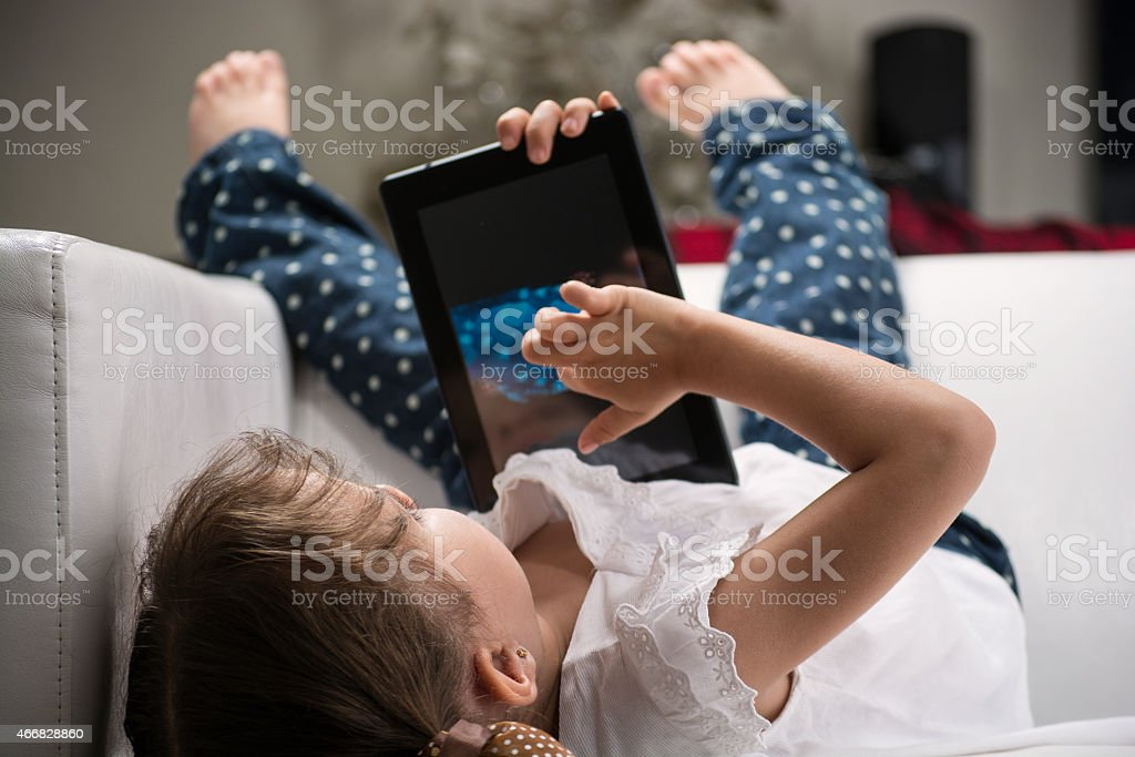 Female child with tablet stock photo