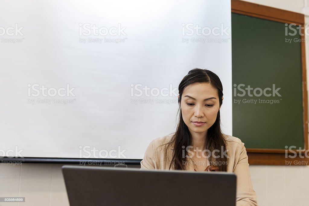 Female Chinese Teacher with Laptop, Hong Kong, China, Asia royalty-free stock photo
