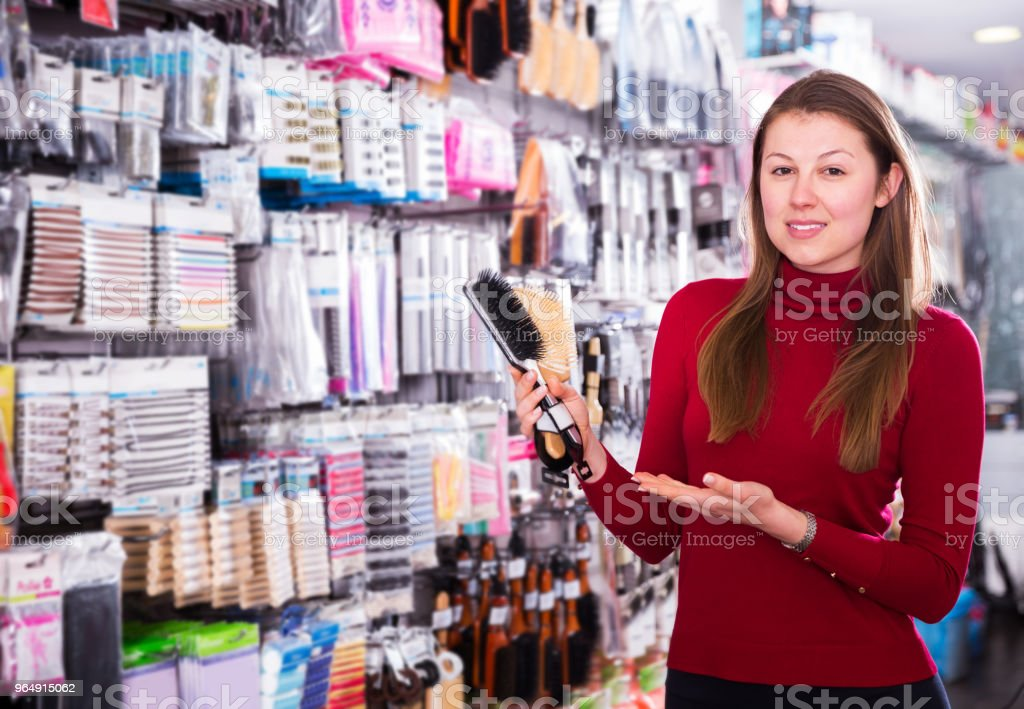 Female choosing hair combs in store royalty-free stock photo