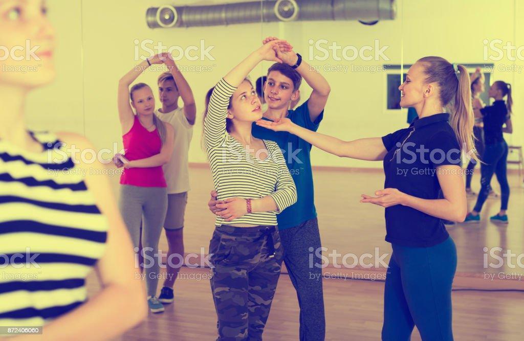 female choreographer teaches children stock photo