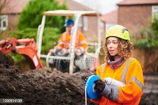 field surveyor on building site