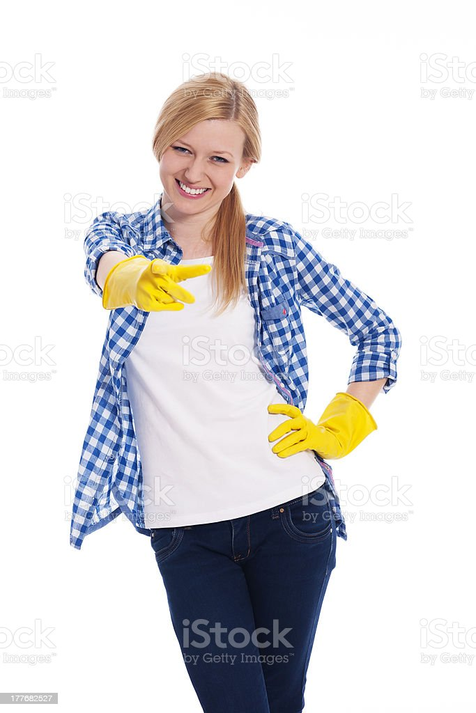 Female cleaner pointing finger at camera royalty-free stock photo