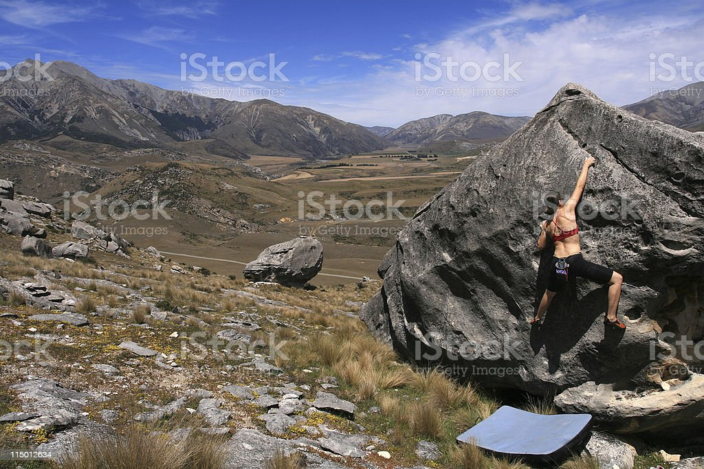 Female climber bouldering in NZ stock photo