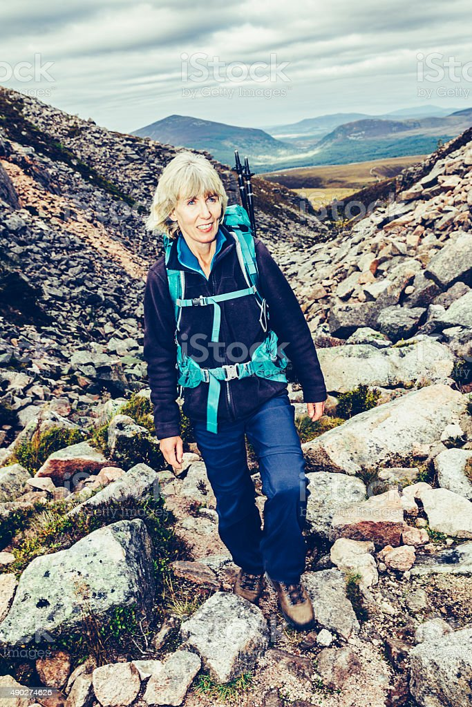 Female climber on Cairngorms, Scotland stock photo