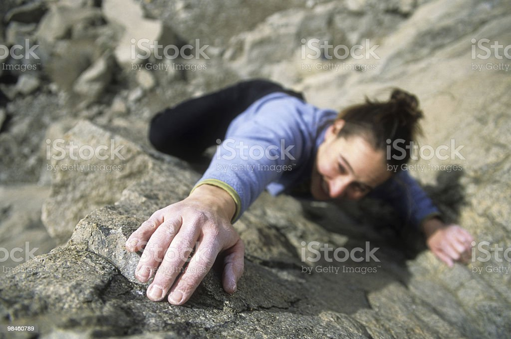 Female Climber Reaching royalty-free stock photo