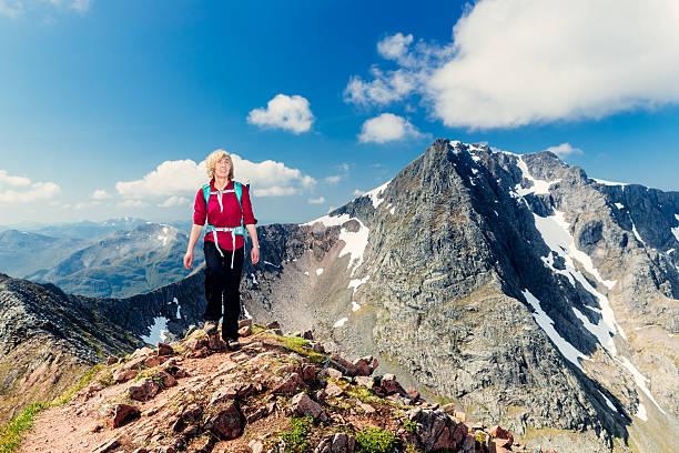 Female climber with Ben Nevis view, Scotland stock photo