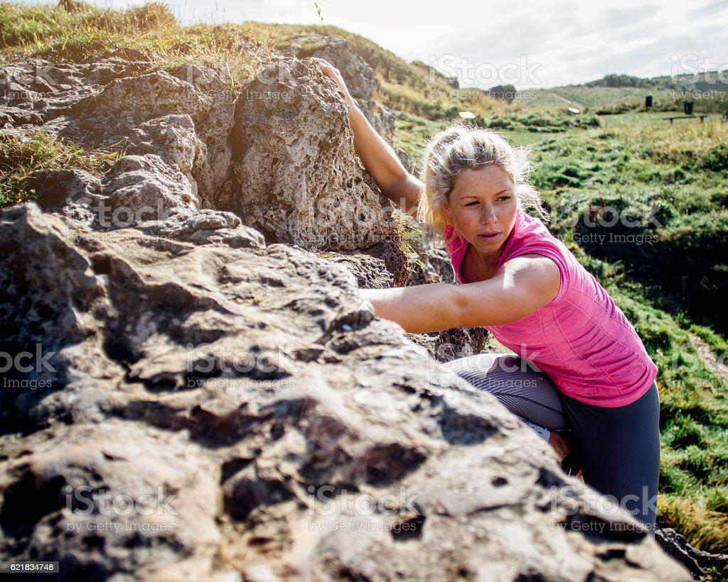 Female Climbing up a Rock Face stock photo