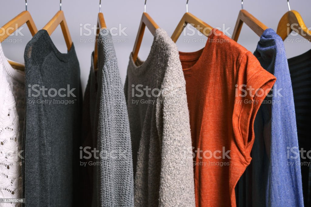 Female clothes hanging on a clothing rack in a shop or home closet stock photo