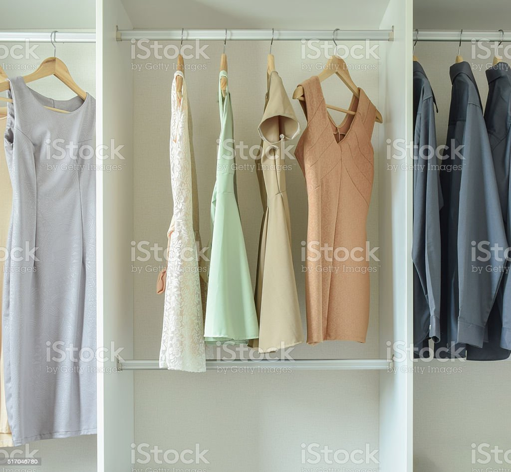 female clothes hanging on hangers in wardrobe stock photo