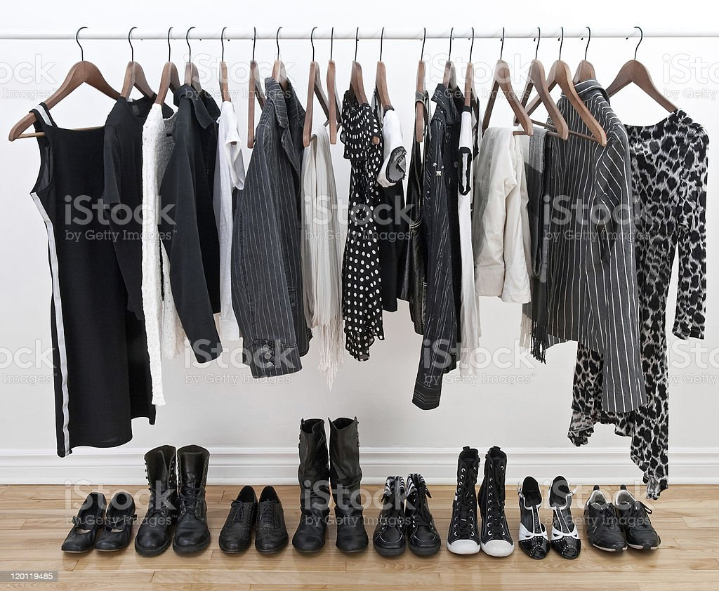 Female clothes on hangers and shoes stock photo