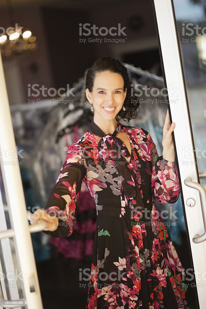 Female Clothing Store Owner Standing At Door royalty-free stock photo