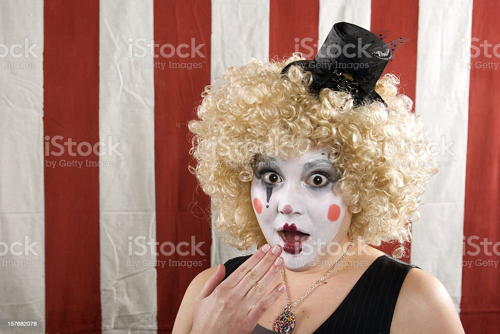 Female clown on  red and white striped back ground royalty-free stock photo