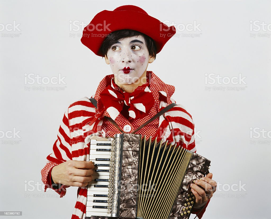 Female clown playing the accordion stock photo