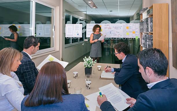 female coach looking project management in business team training - projektledning bildbanksfoton och bilder