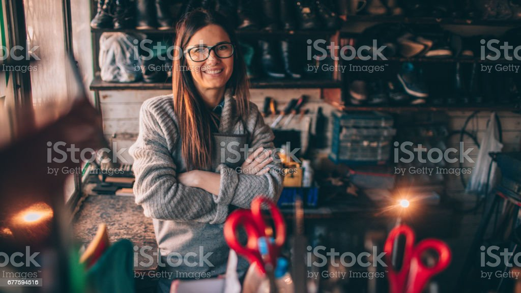 Female cobbler royalty-free stock photo